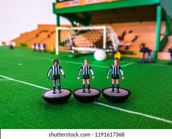 Newcastle Subbuteo football figures lined up on a grass field