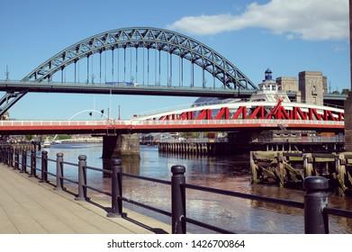 NEWCASTLE / UK - 20th May 2019: The Tyne Bridge and the Swing Bridge over the River Tyne, linking Newcastle and Gateshead