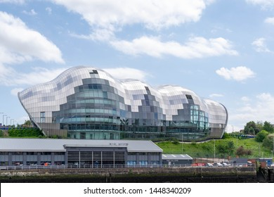 Newcastle, UK - 7 May 2019: Sage Gateshead. Culture centre holding music concerts and art events. On the Tyne river next to famous Tyne Bridge, Swing Bridge, Millennium Bridge and High level bridge