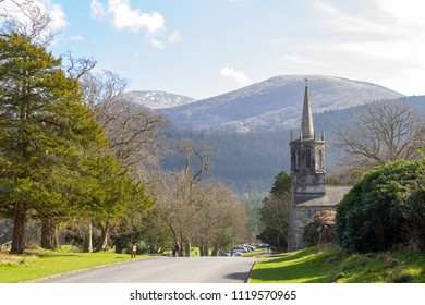 NEWCASTLE, UK - APR 8, 2018: General view at the Clanbrassil Barn at Tollymore Forest Park and mountains in distance, Northern Ireland