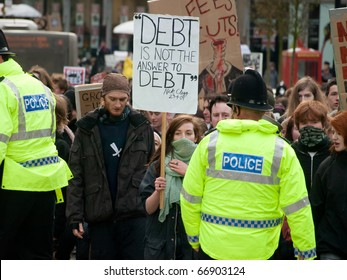 NEWCASTLE, UK - DEC 9: UK university and college students protest against increase in tuition fees and education cuts on the day of vote in the Parliament on December 9, 2010 in Newcastle.