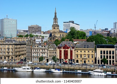 NEWCASTLE, UK – JUNE 11, 2018 - View across the River Tyne towards the city with Saint Willibrord with All Saints church clock tower to the centre, Newcastle upon Tyne, England, UK, June 11, 2018.