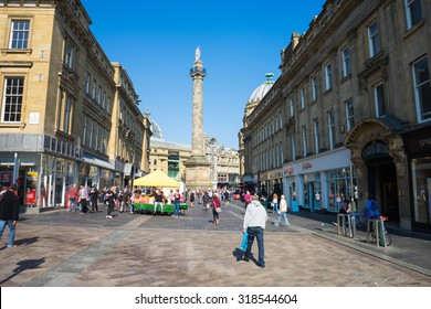 NEWCASTLE, UK, SEPTEMBER 12th, 2015.  Grainger Street, Newcastle Upon Tyne.  Grey's Monument is in the background.  Grainger market is set up, and the market stalls are busy.