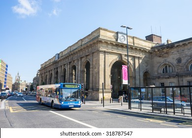 NEWCASTLE, UK, SEPTEMBER 12TH, 2015.  Newcastle Central Station, the main train hub for Newcastle Upon Tyne.  A Stagecoach bus is approaching the bus stop.