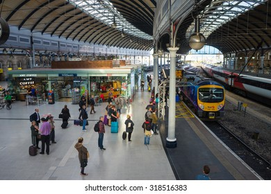 NEWCASTLE, UK, SEPTEMBER 15th, 2015. People waiting to board a train at the main platform of Newcastle Central Station.