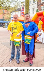 Newcastle Under Lyme, UK. 5th May 2014 The Lymelight Festival. Two young men dressed in Super hero costumes collecting for Douglas Macmillan Hospice at the Lymelight  Festival. England.