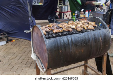 Newcastle Under Lyme, UK. 5th May 2014. Spicy Caribbean Barbequed Chicken on oil drum.