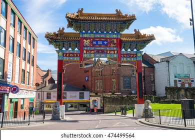 NEWCASTLE UPON TYNE - AUGUST 24th 2016: The entrance to Chinatown, Newcastle Upon Tyne.  Chinese arch, stands 11m tall on St. Andrews Street, Chinatown, flanked by two Chinese guardian lions