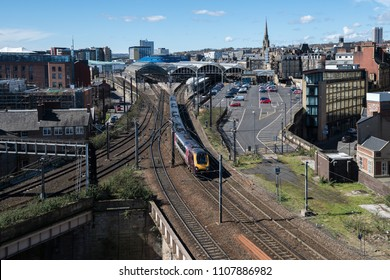 Newcastle upon Tyne, England - April 10 2016: TransPennine Express train heading north on departure from Newcastle upon Tyne Central Station