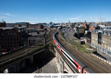 Newcastle upon Tyne, England - April 10 2016: Virgin Train heading south approaching Newcastle upon Tyne Central Station
