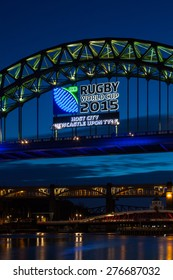 NEWCASTLE UPON TYNE, ENGLAND - JANUARY 24:  The Tyne Bridge with an illuminated banner promoting the 2015 IRB Rugby World Cup pictured on January 24, 2015.  Newcastle is a host city to the event.
