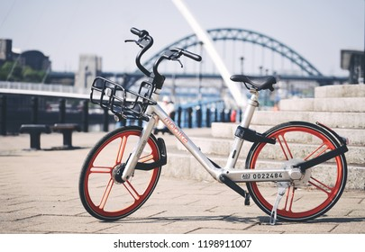NEWCASTLE UPON TYNE, ENGLAND, UK - MAY 08, 2018: A Mobike rent a bike by app on the Newcastle Quayside.