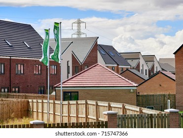 NEWCASTLE UPON TYNE, ENGLAND, UK - AUGUST 15, 2017: Newly built homes by Persimmon  in a residential estate in England.