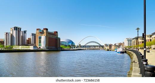 NEWCASTLE UPON TYNE, ENGLAND, UK - MAY 17, 2017: The iconic Tyne & Millennium Bridge over the River Tyne at Newcastle & Gatesheads Quayside.