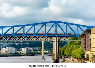 Newcastle upon Tyne, England / United Kingdom - August 27 2018: Queen Elizabeth II Metro Bridge, along Tyne River, distinctive architectural with close-up details and surrounding landscape