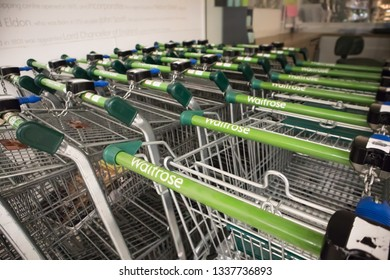 Newcastle upon Tyne / Great Britain - March 12, 2019: Waitrose shopping trolley carts showing company name and branding