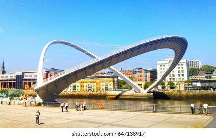 NEWCASTLE UPON TYNE, UK - MAY 25, 2017: Opened Millennium bridge during the sunny day in Newcastle, UK. People watching the bridge with historical buildings at the background