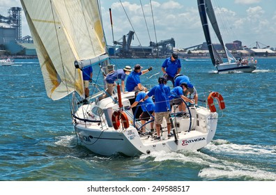NEWCASTLE,AUSTRALIA - JANUARY 24,2015: Members of a local sailing club race their boats on the harbour. Newcastle is the 2nd city of New South Wales, after Sydney.