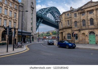 Newcastle,England, November 6, 2018. View of the tyne bridge from sandhill as you head down towards the quayside. there are bicycles lined up on the left and vehicles travelling back and forth.