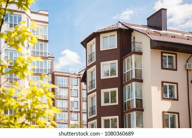 New-constructed multi-storey residential building. multi-storey residential house in brown and beige colors. Modern residential construction. Residential fund