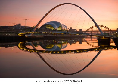 Newcsatle Upon Tyne Millenium Bridge during a dramatic sunrise/sunset