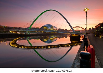 Newcsatle Upon Tyne Millenium Bridge during a dramatic sunrise/sunset with clear reflections