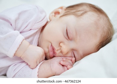 neweborm baby girl sleeping