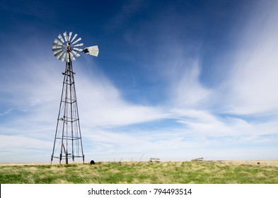 Newell County, Alberta, Canada.  Old windmill on the Canadian Prairies on a warm spring day.