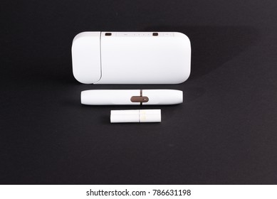 Newest electronic cigarettes, heating tobacco system, smoking, white isolated on black background