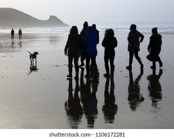 Newgale, Pembrokeshire, Wales- December 30th 2017 : Family group walking the dog on Newgale Beach, Pembrokeshire, Wales