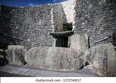 Newgrange entrance with view of the famous Triple Spiral and Diamonds designs.