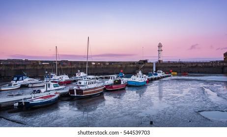 Newhaven harbour at sunrise. Edinburgh, Scotland, United Kingdom