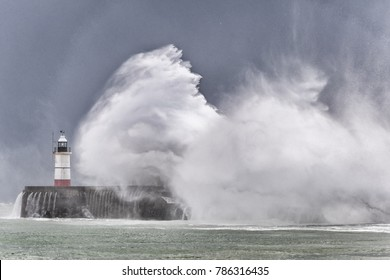 Newhaven, UK, 10/21/2017 Storm Brian huge waves crash over harbour arm sea defence wall and lighthouse