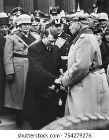 Newly appointed Chancellor Adolf Hitler greets President von Hindenburg at a memorial service. Berlin, 1933. Behind Hitler is Herman Goering and Joseph Goebbels.
