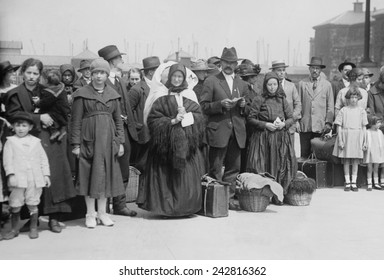 Newly arrived European immigrants at Ellis Island in 1921-21.