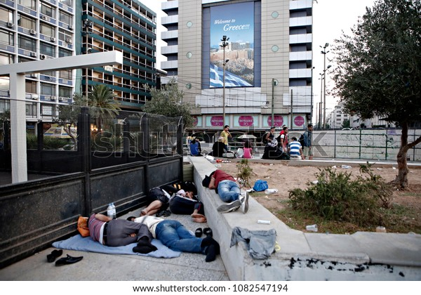 Newly arrived Syrian refugees rest in Omonia square in Athens, Greece on Aug. 16, 2015
