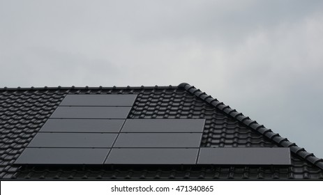 Newly build houses with solar panels attached on the roof against a sunny sky Close up of new building with black solar panels.Urk,Netherlands,Fleovoland