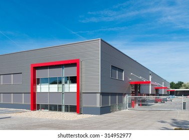 newly build modern red warehouse with offices