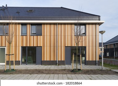 newly build row of modern townhouses in enschede, netherlands