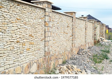 newly builded yellow stone fense