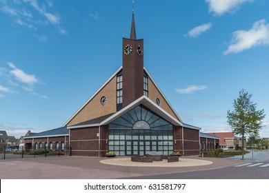 newly built christian church,modern architecture church Urk Netherlands, tower church, painting windows,modern church