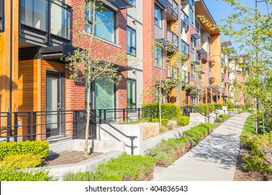 Newly built condos  with nicely trimmed and designed front yard in a residential neighborhood in Canada.