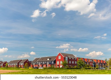 Newly built contemporary red family houses in the Dutch city of Zutphen
