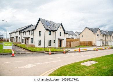 Newly built energy efficient houses with solar panels on the roof in a housing development in Scotland