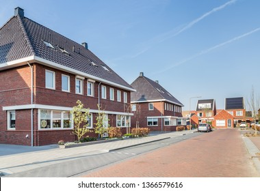 Newly built houses in a family friendly modern suburban neighborhood with solar panels en electric car charger in Veenendaal in the Netherlands.