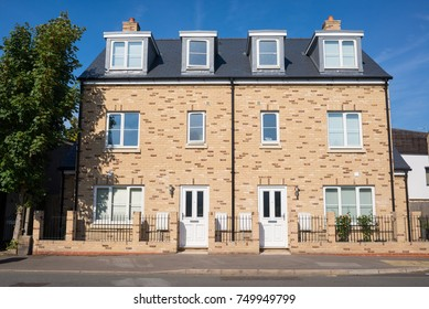 Newly built three floor semi detached houses on an empty street in England, UK