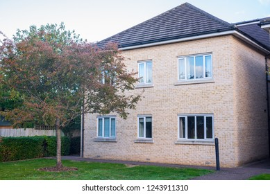 Newly built two floors semi detached apartment house with small garden on the front. England, UK