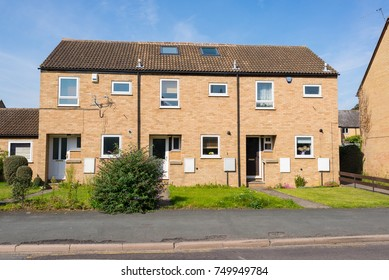 Newly built two floors semi detached council houses with small garden in the front on an empty street in England, UK