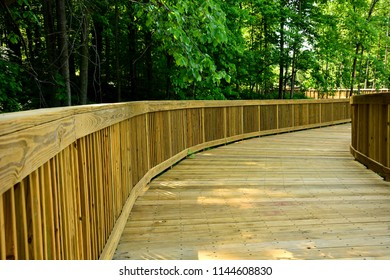 A newly constructed boardwalk biking and hiking pathway through the forested area in Somers Wisconsin at Petrifying Springs Park.