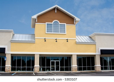 newly constructed commercial mall with stone accents on front faces